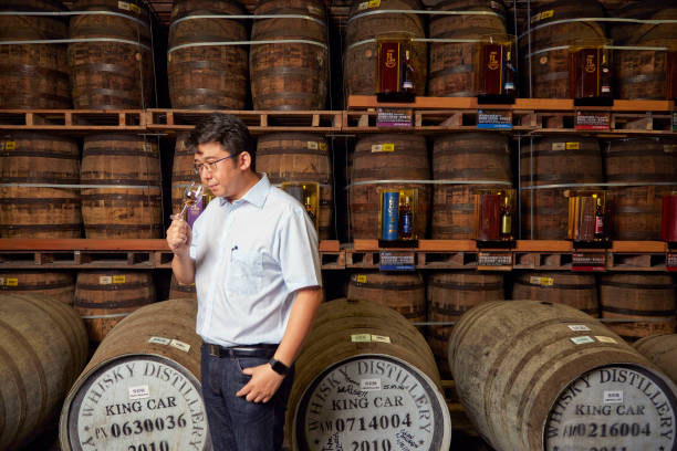 YILAN, TAIPEI, TAIWAN - 2016/09/22: Ian Chang, blendmaster at Kavalan Whisky prepares to taste a new batch of whisky. Established in 2005, the family-owned distillery first came to prominence in 2010 when its single malt topped a blind tasting in Scotland, and has since gone on to win a number of awards. (Photo by Craig Ferguson/LightRocket via Getty Images)